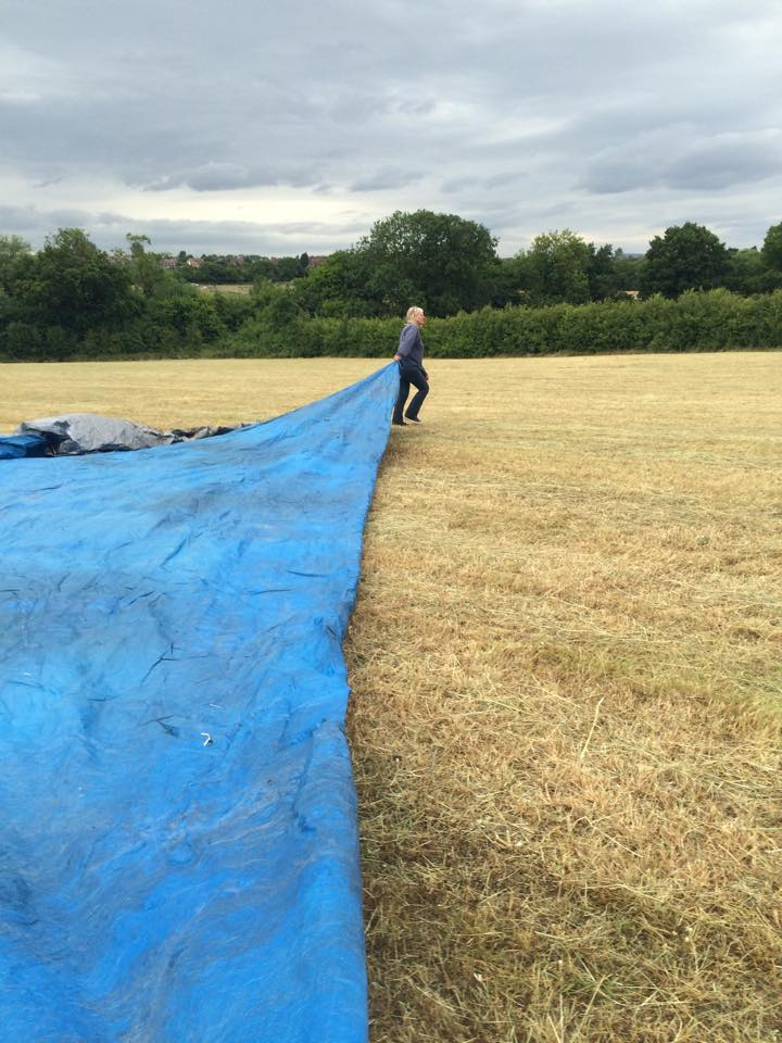 Spreading the tarpaulin